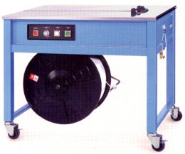Table strapping machines